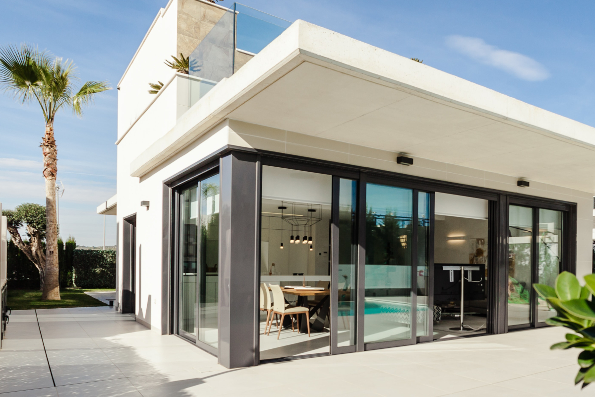 modern home with large glass doors